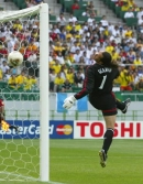 Seaman watches as Ronaldino's shot goes in